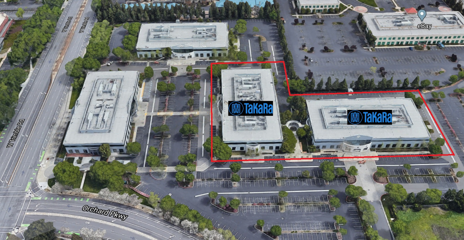 Two office and research buildings at 2560 and 2570 Orchard Parkway in north San Jose that are owned by Takara Bio USA, outlined in red and shown with Takara logo.