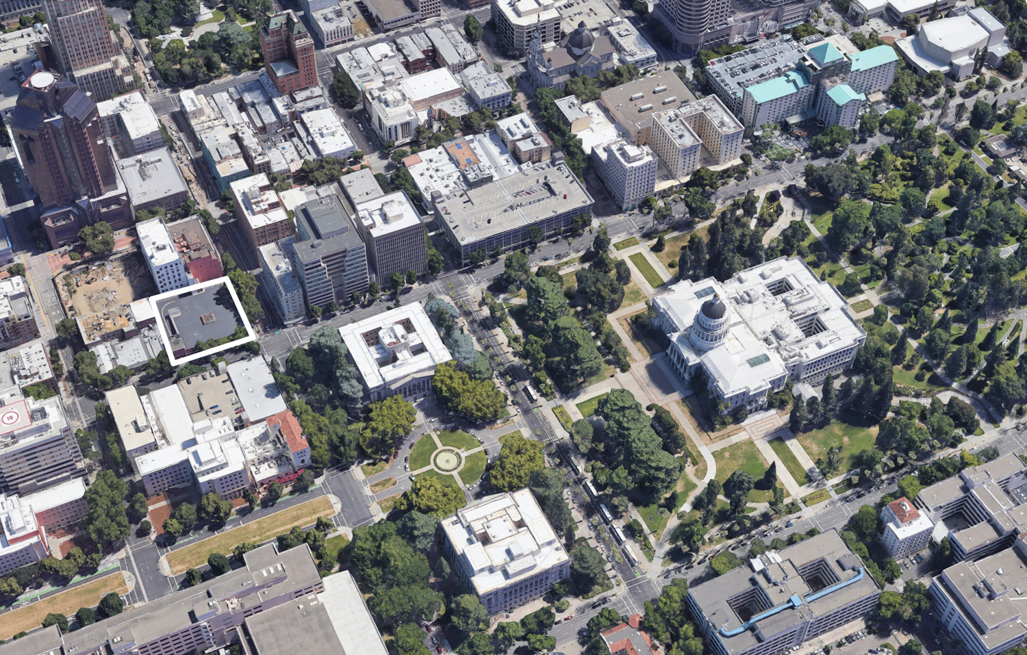 1116 9th Street nearby the State Capitol, image via Google Satellite with white outline of the development parcel, SFYIMBY