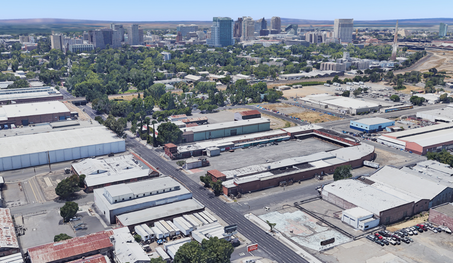 200, 211, and 215 North 16th Street with the Sacramento skyline in the background, image via Google Satellite